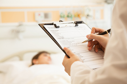 http://www.dreamstime.com/stock-photo-close-up-doctor-writing-medical-chart-patient-lying-hospital-bed-background-image33401120