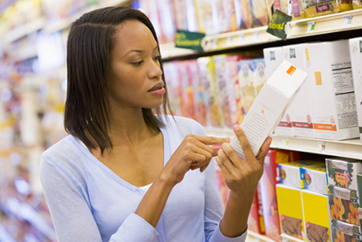 Woman checking food label in store