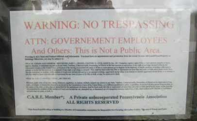 During a 2010 tour at Miller's Organic Farm, this photo of a trespass warning to the public and government was photographed.