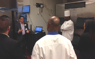 Steve Russak, COO of CloudClean, describes the capabilities of a new hand wash performance system with chefs from a variety of casino kitchens Tuesday. The system converts current handwash rules into a staff reminder and reporting program. The electronic network set up for handwash verification has a secondary use for tracking temperatures during food preparation and storage. (Photo by Jim Mann)